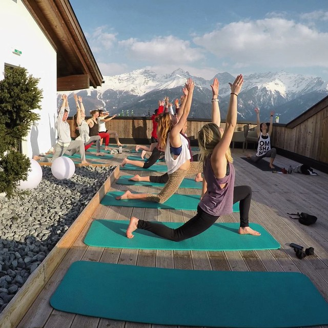 This is how yoga should be done. If you don't happen to have a handy Alpine roof terrace, a village hall will do nicely. Photo courtesy of Anna Langer.